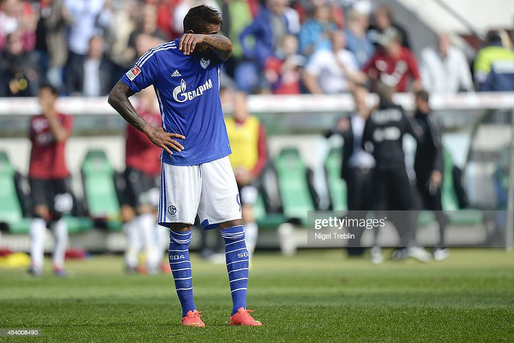 <a gi-track='captionPersonalityLinkClicked' href=/galleries/search?phrase=Kevin-Prince+Boateng&family=editorial&specificpeople=613049 ng-click='$event.stopPropagation()'>Kevin-Prince Boateng</a> of Schalke reacts after the Bundesliga match between FC Schalke 04 and Hannover 96 at HDI-Arena on August 23, 2014 in Hanover, Germany.
