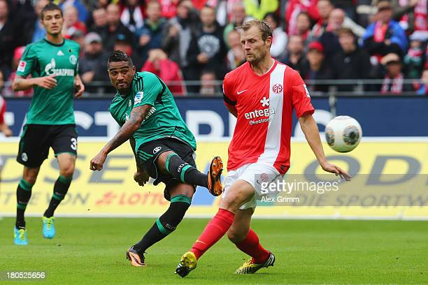 KevinPrince Boateng of Schalke scores his team's first goal against Bo Svensson of Mainz during the Bundesliga match between 1 FSV Mainz 05 and FC...
