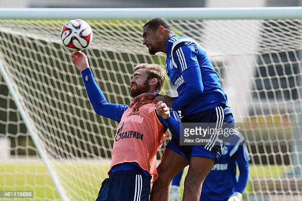 KevinPrince Boateng outjumps Jan Kirchhoff during day 7 of the FC Schalke 04 training camp at the ASPIRE Academy for Sports Excellence on January 12...