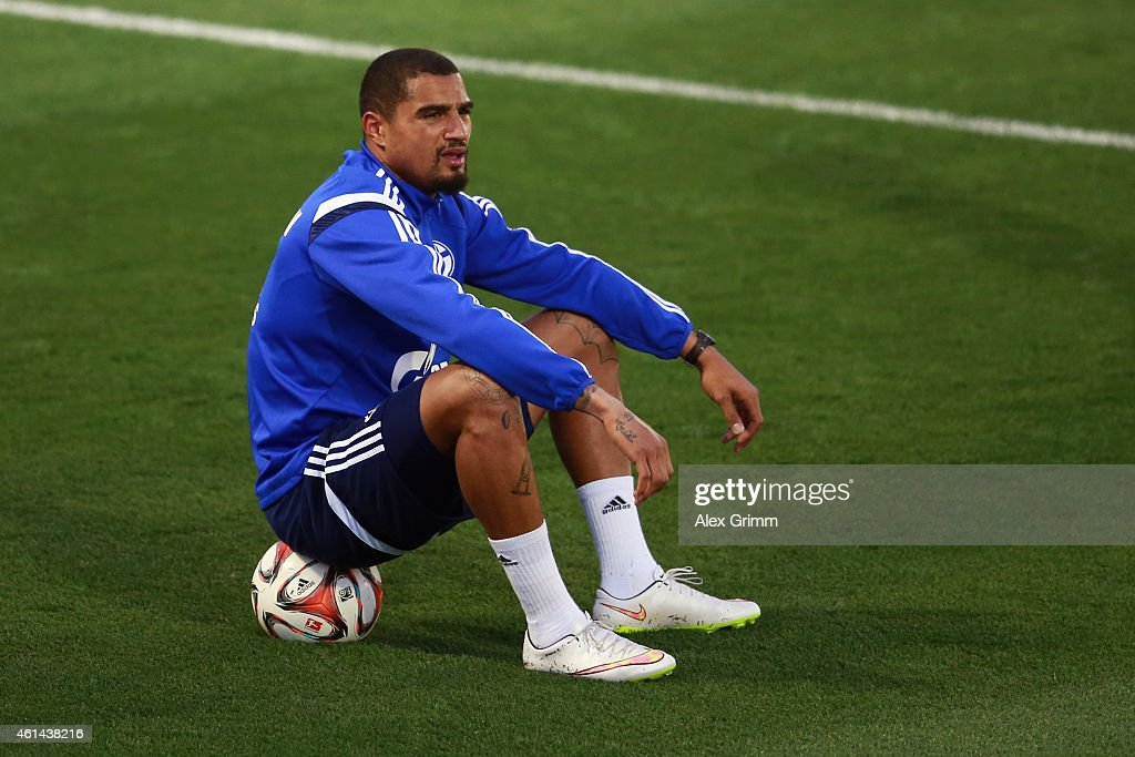 Kevin-Prince Boateng sits on the ball during day 7 of the FC Schalke 04 training camp at the ASPIRE Academy for Sports Excellence on January 12, 2015 in Doha, Qatar.