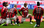 KevinPrince Boateng with his teammates of AC Milan wear the jersey against racism during the Serie A match between AC Milan and AC Siena at San Siro...