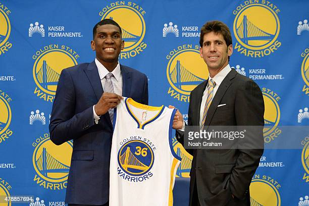 Kevon Looney and Bob Myers of the Golden State Warriors pose for a portrait during a draft press conference at the Warriors Training Center on June...