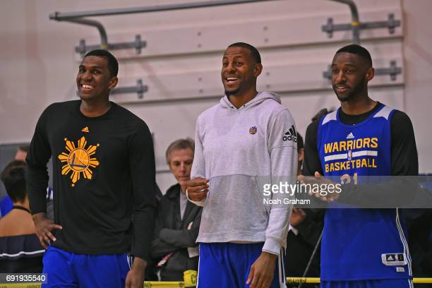Kevon Looney Andre Iguodala and Ian Clark of the Golden State Warriors smile and look on during practice and media availability as part of the 2017...