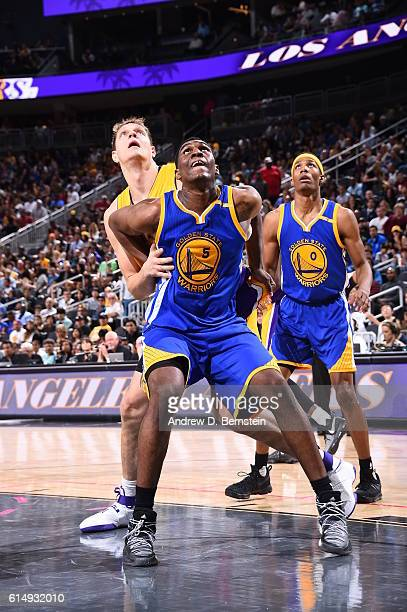 Kevon Looney of the Golden State Warriors boxes out Timofey Mozgov of the Los Angeles Lakers during a preseason game on October 15 2016 at the...