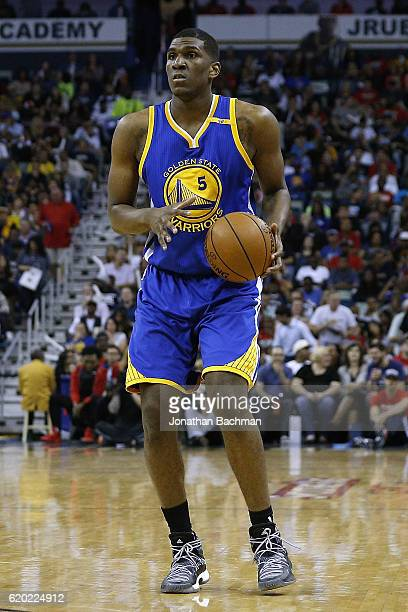 Kevon Looney of the Golden State Warriors drives with the ball during a game against the New Orleans Pelicans at the Smoothie King Center on October...