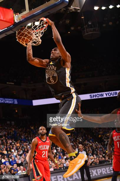 Kevon Looney of the Golden State Warriors dunks against the New Orleans Pelicans on November 25 2017 at ORACLE Arena in Oakland California NOTE TO...