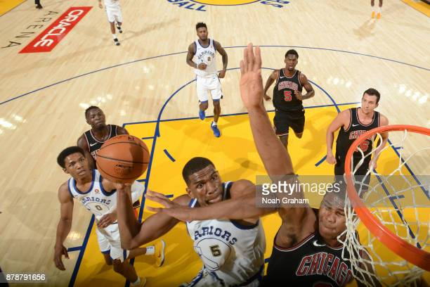 Kevon Looney of the Golden State Warriors goes to the basket against the Chicago Bulls on November 24 2017 at ORACLE Arena in Oakland California NOTE...