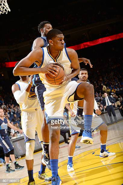 Kevon Looney of the Golden State Warriors grabs the rebound against the Dallas Mavericks on January 27 2016 at ORACLE Arena in Oakland California...