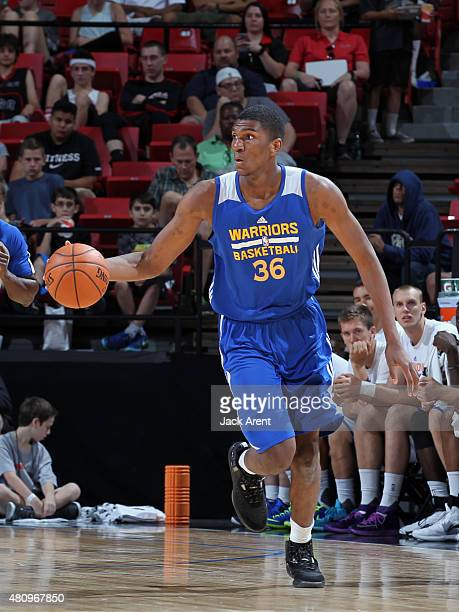 Kevon Looney of the Golden State Warriors handles the ball against the New York Knicks on July 16 2015 at the Thomas Mack Center in Las Vegas Nevada...