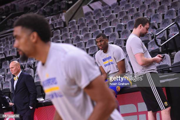 Kevon Looney of the Golden State Warriors looks on during warm ups before Game Four of the Western Conference Finals against the San Antonio Spurs...