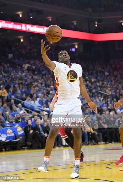 Kevon Looney of the Golden State Warriors reaches out for a pass against the Chicago Bulls during an NBA basketball game at ORACLE Arena on February...