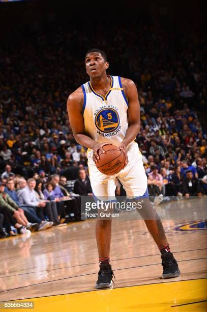 Kevon Looney of the Golden State Warriors shoots a free throw against the Sacramento Kings on February 15 2017 at ORACLE Arena in Oakland California...