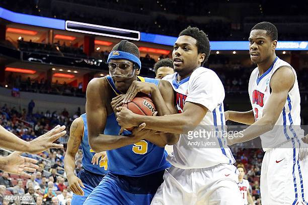 Kevon Looney of the UCLA Bruins and Sterling Brown of the Southern Methodist Mustangs fight for a loose ball during the second round of the 2015 NCAA...
