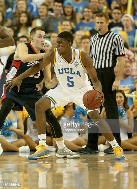 Kevon Looney of the UCLA Bruins controls the ball against Kyle Wiltjer of the Gonzaga Bulldogs at Pauley Pavilion on December 13 2014 in Los Angeles...