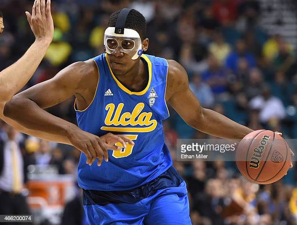 Kevon Looney of the UCLA Bruins drives against the Arizona Wildcats during a semifinal game of the Pac12 Basketball Tournament at the MGM Grand...