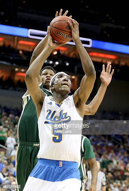 Kevon Looney of the UCLA Bruins drives past William Lee of the UAB Blazers during the third round of the 2015 NCAA Men's Basketball Tournament at KFC...