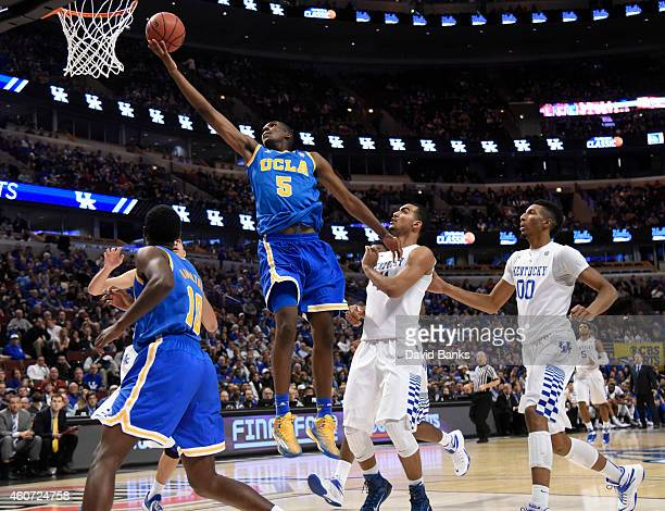 Kevon Looney of the UCLA Bruins drives to the basket against Trey Lyles of the Kentucky Wildcats during the second half of the CBS Sports Classic on...