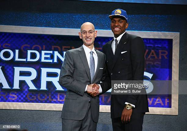 Kevon Looney shakes hands with NBA Commissioner Adam Silver after being selected number thirty overall by the Golden State Warriors during the 2015...