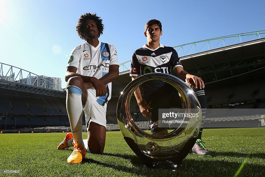 Kew Jaliens of Melbourne City FC and Guilherme Finkler of Melbourne Victory pose with the championship trophy during a Melbourne Semi Final ALeague...