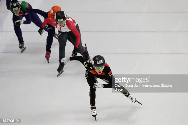 Kexin Fan of China and Marianne StGelais of Canada compete in the Ladies 3000m Relay Semifinals during the Audi ISU World Cup Short Track Speed...