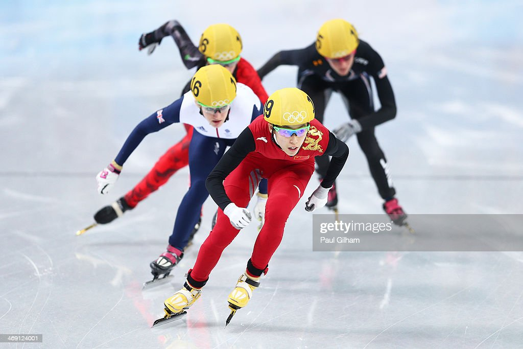 Kexin Fan of China, <a gi-track='captionPersonalityLinkClicked' href=/galleries/search?phrase=Elise+Christie&family=editorial&specificpeople=4113885 ng-click='$event.stopPropagation()'>Elise Christie</a> of Great Britain <a gi-track='captionPersonalityLinkClicked' href=/galleries/search?phrase=Jessica+Hewitt&family=editorial&specificpeople=10029266 ng-click='$event.stopPropagation()'>Jessica Hewitt</a> of Canada and <a gi-track='captionPersonalityLinkClicked' href=/galleries/search?phrase=Emily+Scott+-+Speed+Skater&family=editorial&specificpeople=15291931 ng-click='$event.stopPropagation()'>Emily Scott</a> of the United States compete in the Women's Short Track 500m heats on day 6 of the Sochi 2014 Winter Olympics at at Iceberg Skating Palace on February 13, 2014 in Sochi, Russia.