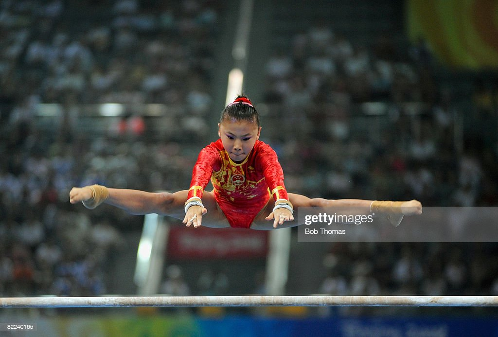 Kexin He of China performs on the uneven bars during qualification for the women's artistic gymnastics event held at the National Indoor Stadium during Day 2 of the 2008 Summer Olympic Games on August 10, 2008 in Beijing, China.