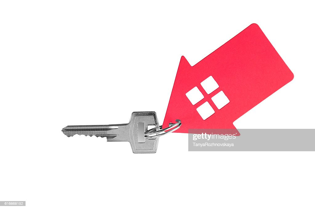 Key and keychain in the shape of a house. : Stock Photo