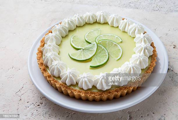 Key lime pie with graham cracker crust and whipped cream