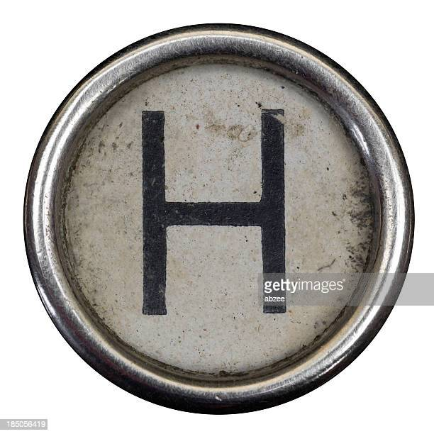 H key of a full alphabet from grungey typewriter