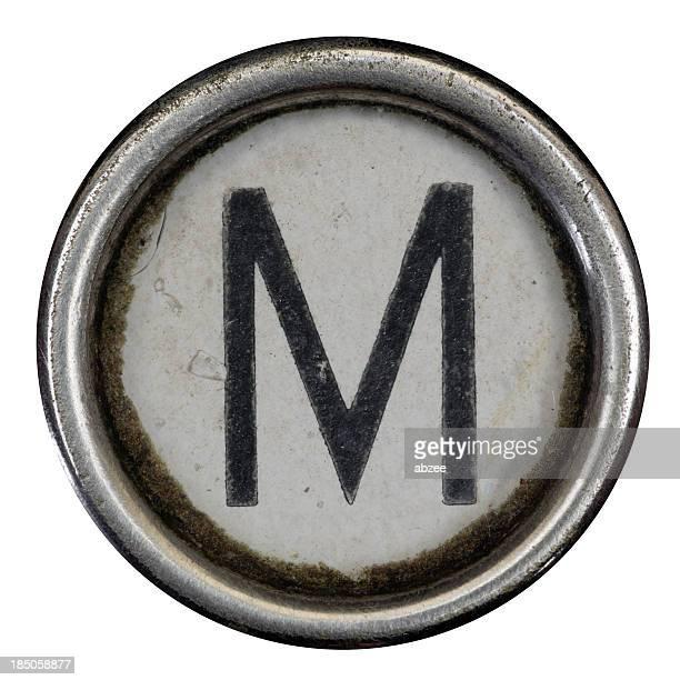 M clé d'une lettre de l'alphabet de grungey machine à écrire