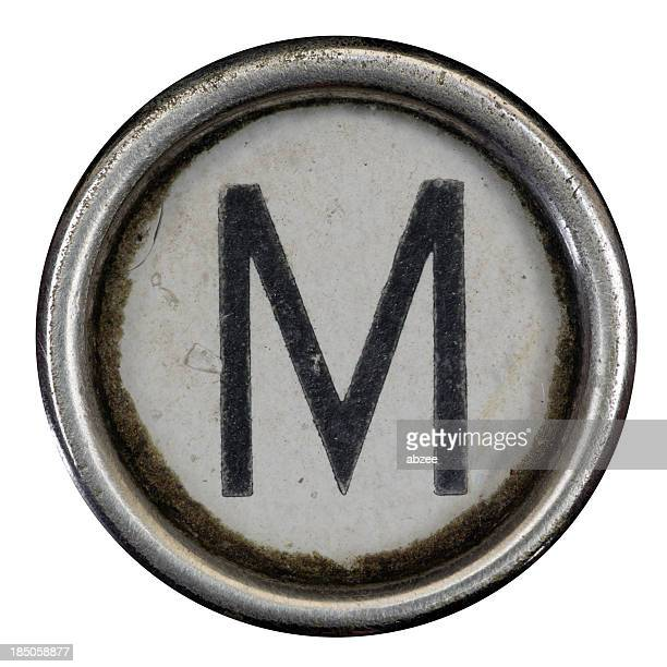 M key of a full alphabet from grungey typewriter