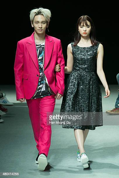 Key of South Korean boy band SHINee and Yagi Arisa showcase designs on the runway during the JARRET show as part of Seoul Fashion Week F/W 2014 on...