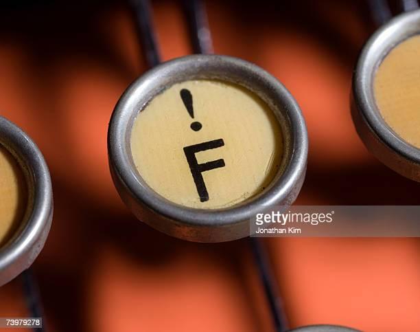 Key on antique typewriter, close-up