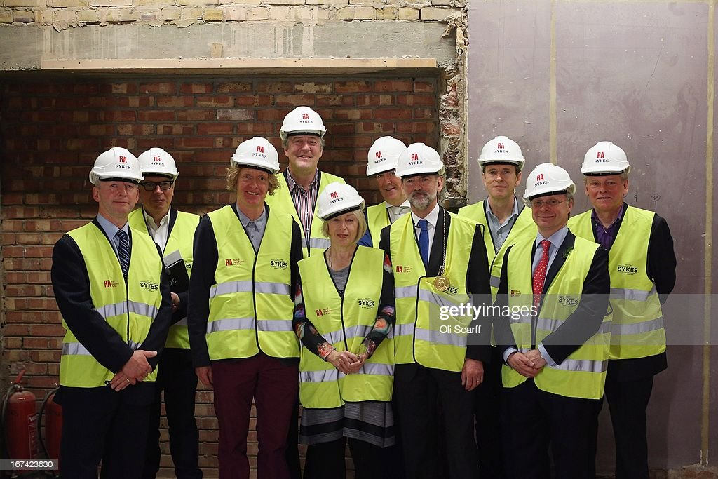 Key personnel in in the redevelopment of Keeper's House at the Royal Academy of Arts attend the 'Topping Out Ceremony' on April 25, 2013 in London, England. The Royal Academy of Arts is celebrating the architectural milestone in the redevelopment of Keeper's House; a major project to transform facilities for visitors to the Royal Academy. The work, which opens to the public in autumn 2013, is being undertaken by architects Long & Kentish, with interior design by <a gi-track='captionPersonalityLinkClicked' href=/galleries/search?phrase=David+Chipperfield&family=editorial&specificpeople=2103568 ng-click='$event.stopPropagation()'>David Chipperfield</a> Architects. The space includes a new restaurant, bar and walled garden. (L-R) Managing Director of Sykes & Son Andrew Burr, architect Professor Sir <a gi-track='captionPersonalityLinkClicked' href=/galleries/search?phrase=David+Chipperfield&family=editorial&specificpeople=2103568 ng-click='$event.stopPropagation()'>David Chipperfield</a>, Royal Academician <a gi-track='captionPersonalityLinkClicked' href=/galleries/search?phrase=Grayson+Perry&family=editorial&specificpeople=208176 ng-click='$event.stopPropagation()'>Grayson Perry</a>, Royal Academy Trustee <a gi-track='captionPersonalityLinkClicked' href=/galleries/search?phrase=Stephen+Fry&family=editorial&specificpeople=210809 ng-click='$event.stopPropagation()'>Stephen Fry</a>, Keeper of the Royal Academy Schools Eileen Cooper, Chief Executive of the Royal Academy of Arts Charles Saumarez Smith, President of the Royal Academy of Arts Christopher Le Brun, restauranteur Oliver Peyton, Ronald Zeghibe, architect Rolfe Kentish.
