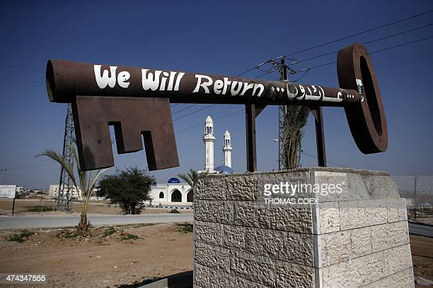 A key symbolizing the Palestinians who lost their homes at the creation of of State of Israel in 1948 is displayed at the entrance of the West Bank...