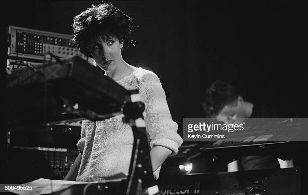 Keyboard player Gillian Gilbert performing with English rock group New Order at Salford University 17th April 1985 On the right is singer and...