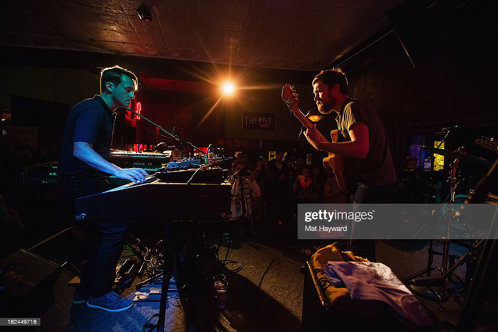 Keyboard player Mark Bond (L) and singer/guitarist Matt Pelham of the Features perform during an EndSession hosted by 107.7 The End at the J&M Cafe on September 29, 2013 in Seattle, Washington.