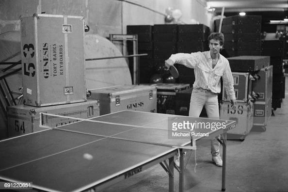 Keyboard player Tony Banks of English rock group Genesis playing table tennis backstage at the Rosemont Horizon Rosemont Illinois during the band's...