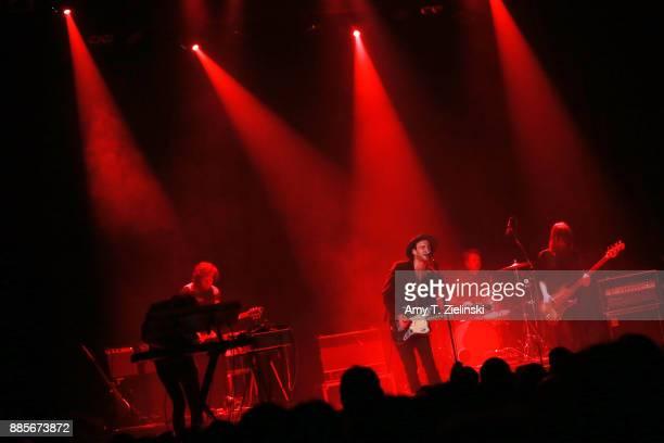 Keyboard player Uberto Rapisardi guitarist Liam Gerrard lead singer Finn Andrews and bassplayer Sophia Burn of the Londonbased band The Veils perform...