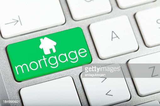 A keyboard with a single green key reading Mortgage