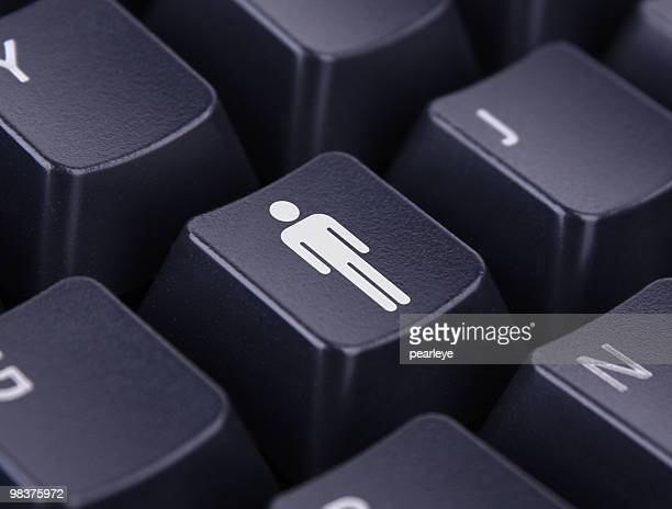 A keyboard with one key representing an icon of a man