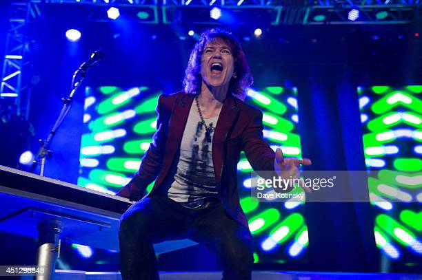 Keyboardist and singer Lawrence Gowan of the group Styx performs at Prudential Center on June 26 2014 in Newark New Jersey