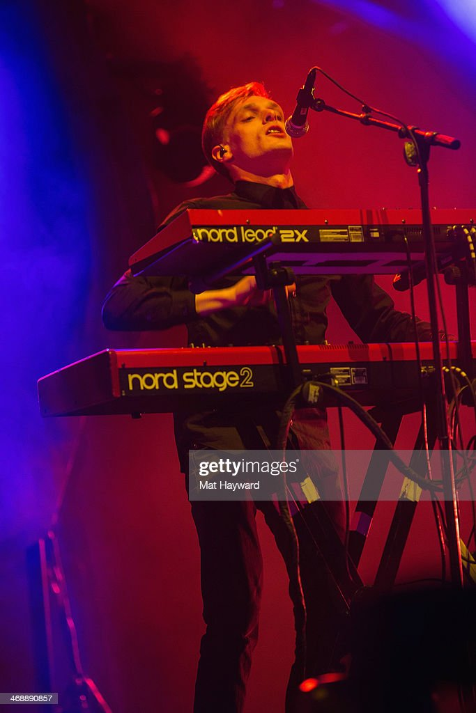 Keyboardist Casey Harris of X Ambassadors performs on stage at KeyArena on February 11, 2014 in Seattle, Washington.
