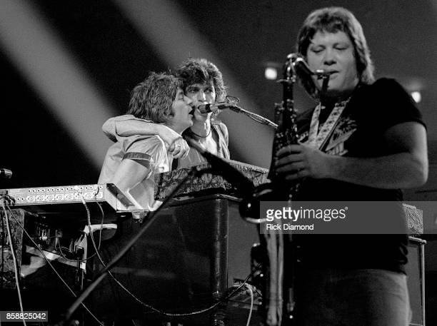 L/R Keyboardist Ian McLagan Guitarist Keith Richards and Saxophonist Bobby Keys perform with The New Barbarians at The OMNI Coliseum in Atlanta...