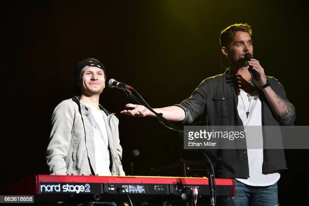 Keyboardist Kyle Schlienger and singer Brett Young perform onstage during the ACM Party For A Cause The Joint at The Joint inside the Hard Rock Hotel...