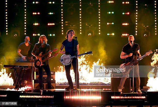Keyboardist Nathan Barlowe guitarist Danny Rader recording artist Keith Urban and bassist Jerry Flowers perform onstage during the 51st Academy of...