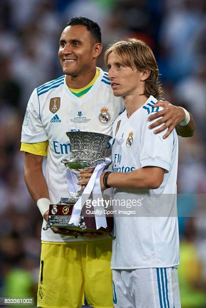 Keylor Navas and Luka Modric of Real Madrid celebrates with the trophy after winning the Supercopa de Espana Supercopa Final 2nd Leg match between...