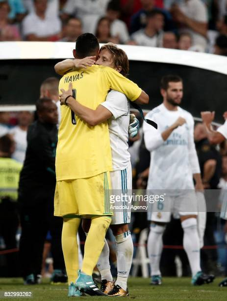 Keylor Navas and Luka Modric Real Madrid hug as they celebrate winning the Spanish Super Cup in the return match against Barcelona at Santiago...