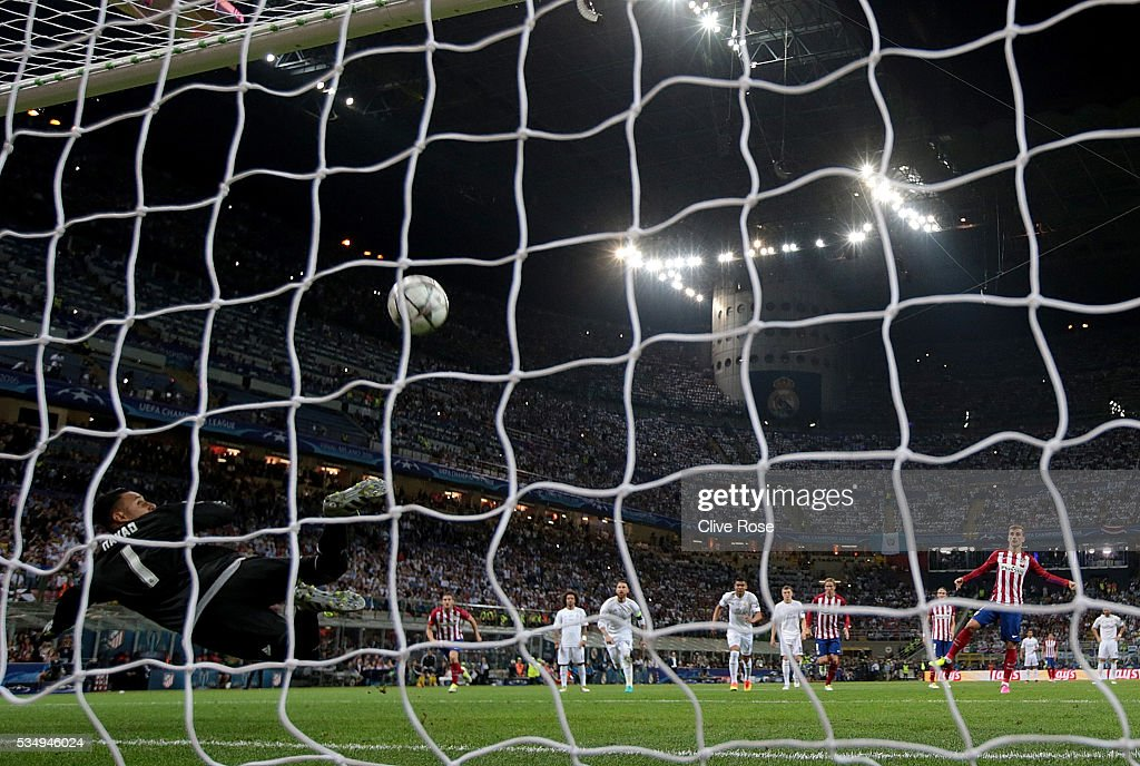 <a gi-track='captionPersonalityLinkClicked' href=/galleries/search?phrase=Keylor+Navas&family=editorial&specificpeople=2097517 ng-click='$event.stopPropagation()'>Keylor Navas</a> goalkeeper of Real Madrid looks at the ball as it rebounds off the crossbar as <a gi-track='captionPersonalityLinkClicked' href=/galleries/search?phrase=Antoine+Griezmann&family=editorial&specificpeople=7197539 ng-click='$event.stopPropagation()'>Antoine Griezmann</a> of Atletico Madrid misses a penalty during the UEFA Champions League Final match between Real Madrid and Club Atletico de Madrid at Stadio Giuseppe Meazza on May 28, 2016 in Milan, Italy.