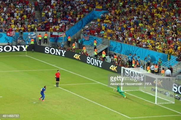 Keylor Navas of Costa Rica saves a penalty kick by Theofanis Gekas of Greece during the 2014 FIFA World Cup Brazil Round of 16 match between Costa...